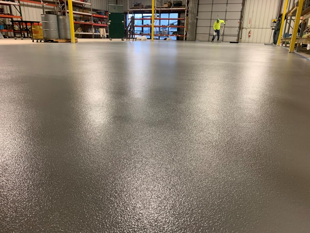 Sand and oxide broadcast industrial epoxy flooring.