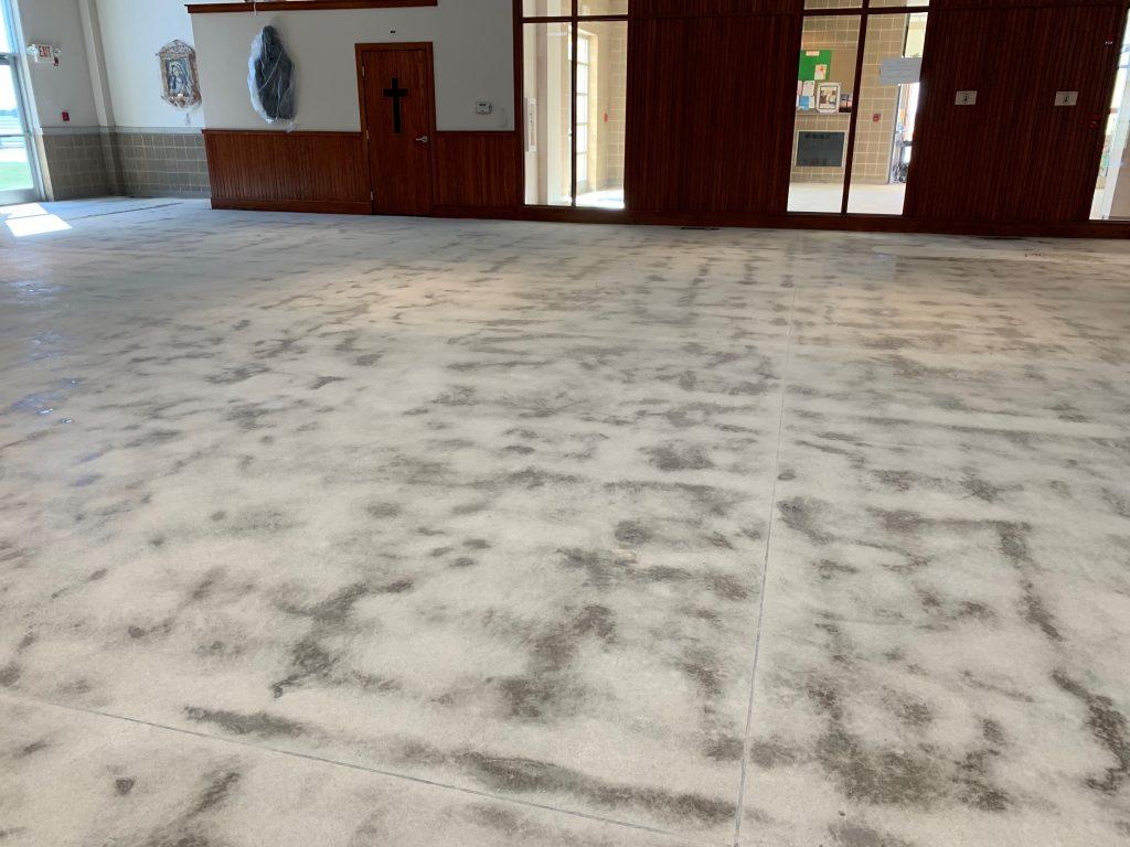 Wavy Concrete Floor Shows Uneven Finish After Concrete Grinding